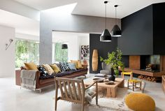 light brown leather couch Living Room Contemporary with arc lamp black accent