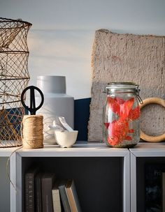 In need of some new ideas for decorating your living room this holiday? Make a DIY snow globe! IKEA has many different glass containers and glass jars that you can use, such as KORKEN glass jar with lid.