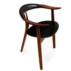 Arne Hovmand-Olsen: Three-legged armchair with oak frame and teak armrests, seat and back with black leather. Manufactured by Mogens Kold Møbelfabrik.