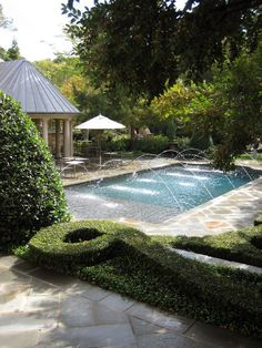 Pool with water sprays.  In Birmingham, AL, get awesome sprinkler service from www.BlueSkyRain.com and landscape lighting too. #irrigation #garden