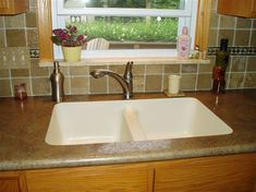 Undermount in Laminate Counter (will replace with quartz) (not my kitchen)
