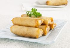 Asian spring rolls are stuffed with vegetables and chicken then shallow-fried till crispy and delicious.