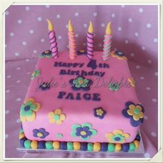 Pink birthday cake with candles