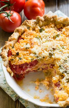 Savory Tomato Pie- a southern favorite. Juicy summer tomatoes mixed with mayonnaise and cheddar cheese. Serve warm.