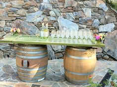 "I love this idea! Two wine barrels topped with an old door as its top  used in the garden as the ""welcome table"" with champagne. I took this picture at a vineyard in Sonoma at a winemakers dinner we went to."