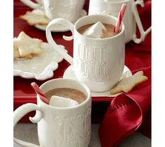 White Alphabet Mugs from Pottery Barn. Darling gift idea… Fill them with coffee, liqueur, hot chocolate, tea, candy &/or fun stir sticks for a lovely Christmas/hostess gift. Each of these one-of-a-kind gift mugs features a different letter design, handle style and cup shape. 10–16 fluid-ounce capacity. Hand-formed molds made of glazed stoneware. Microwave- and dishwasher-safe.