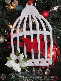 Adorable ornament featuring Tim Holtz Caged Bird die.  Ornament by Nichol Magouirk.