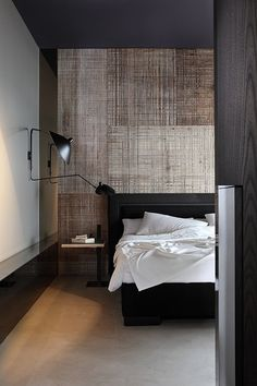 Absolutely adore this bedroom. I thought that was a piece of art but I think it's a textured paint job on the back wall. Stunning. And other than that, it's just a bed, lamp, and night stand. Simplicity.