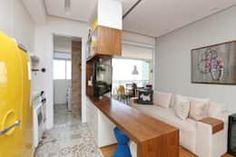 Living e Cozinha integrados: Salas de estar ecléticas por Duda Senna Arquitetura e Decoração
