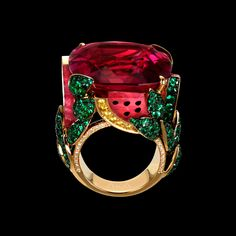 "Limelight ""Watermelon Dream"" cocktail inspiration ring in 18K yellow gold, set with a cushion-cut rubellite (approx. 37.26 ct), 280 brilliant-cut emeralds (approx. 4.13 ct), 4 rubellite balls (approx. 9.05 ct), 34 brilliant-cut yellow diamonds (approx. 0.75 ct) and 45 brilliant-cut diamonds (approx 0.16 ct). - Piaget Luxury Jewellery"