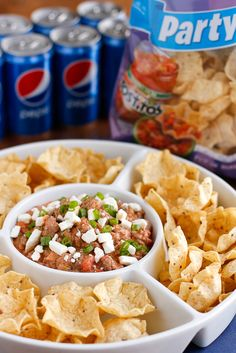 Cheeseburger Dip -- filled with ground beef, salsa, jalapenos, sour cream and feta cheese, this delicious and easy dip recipe is perfect for the Big Game and beyond!