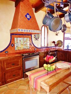 Kitchen using Mexican tiles by kristiblackdesigns.com