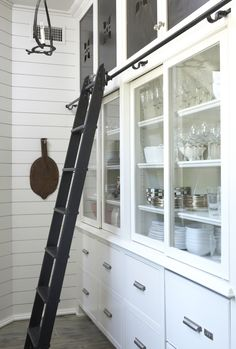 Hmmm... good point - if we're going to have a rolling library ladder, we'd Need doors that Slide not open.  Kitchen Designs & Kitchen Inspiration | Cultivate.com