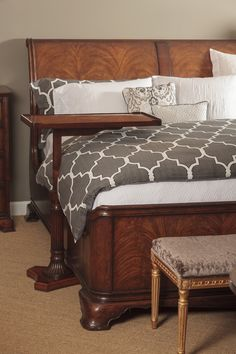 Crotch walnut sleigh bed after the French style, with high sloping headboard and low foot end, carved moulded frame and apron all on kick-out bracket feet. #JonathanCharles #Windsor #Furniture #InteriorDesign #Hpmkt #Decorex
