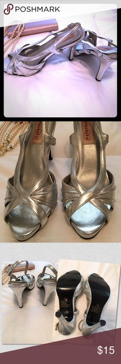 "Dyeables High Heeled shoes EUC !! Silver strappy high heeled shoes worn only twice for two separate special occasions. A few scuffs on the heels, but excellent condition overall. Size 7B, 4"" heels. Neutral silver can dress up a pair of jeans or can be worn with special evening attire. Dyeables Shoes Heels"