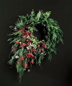 Why settle for a standard wreath? This holiday season, try these easy DIY ideas to create the perfect seasonal decoration. From Real Simple magazine. Winter Holidays, Winter Christmas, Christmas Holidays, Christmas Crafts, Christmas Decorations, Christmas Ideas, Christmas Flowers, Christmas Door, Holiday Wreaths