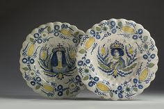 """PAIR OF DUTCH DELFT POLYCHROME ROYAL PORTRAIT CHARGERS, 1690-1700. Each painted in blue, yellow and green and depicting a half-length portrait of Queen Mary II beneath the initials """"MR,"""" and a portrait of William, Prince of Orange beneath the initials """"WR,"""" each flanked by large tulips and the lobed rim with matching border, the second marked RO 50 in underglaze-blue. Diameters 13 3/4 and 13 3/8 inches. Delft, Queen Mary Ii, Prince Of Orange, Defender Of The Faith, Old Plates, William And Mary, Royal Copenhagen, Pottery Making, Glazes For Pottery"""