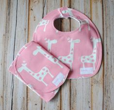Butterfly Kisses on Etsy. Fantastic bibs & burp cloths, terry on one side, patterned cotton on the other.