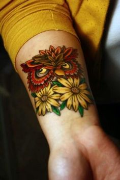 beautiful yellow daisy owl watercolor tattoo on wrist for you