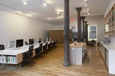 Open office loft, wood floors, white walls, cast iron columns, 13 ft high celings, open plan workstations.