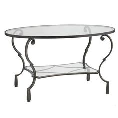 Ours exclusively, the Chasca Table combines a hand-forged, hand-painted iron base with clear, durable tempered glass top and shelf. A brilliant way to add functionality without taking up visual space.