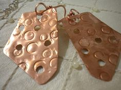 HAMMERED BY HAND.....Circle Stamped Copper Hammered Holey Roller by TrueSelfStudio, $22.00