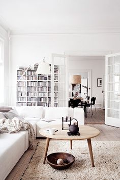 Danish style living room with white, wood, and dark accents. lots of layering adds dimension