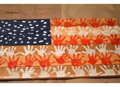 We made this hand print American flag on rough cut cedar boards to hang in our house year round or you could use it to decorate for the 4th of July, Memorial Day, or Veterans Day. It was so easy and fun to make!