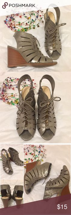 """Lace-up Wedged Shoes Jasmin lace-up wedged sandals Style: Snooze Color:Gun metal/metallic  Size: 8.5 M Lace-up with zipper on the sides and exposed heel  Heel: about 4 """" Good used condition. Questions?  Please ask prior to purchasing Shoes Wedges"""