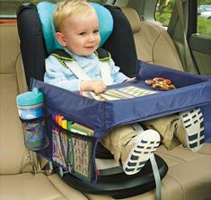 "Child Safe Portable On The Go Waterproof Play 'n' Snack Tray Snack & Play travel tray provides a sturdy surface for travel treats and toys, firm enough to eat on, play upon, read, etc. Tray buckles around the child, use with car seats, booster seats, strollers, on airplanes, in movie theaters, etc. Has 2"" padded rim to keep toys and snacks on tray. Has two large mesh side pockets. Made of foam and nylon. I need this!"