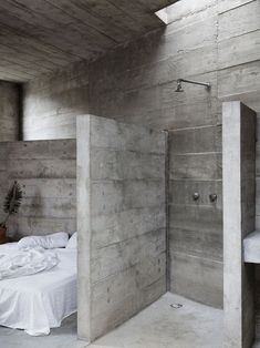 A stickler to the minimalistic principle of the Brutalist Style as only concrete half walls separate Concrete Architecture, Interior Architecture, Futuristic Architecture, Concrete Bathtub, Concrete Ceiling, Concrete Wood, Concrete Interiors, Concrete Houses, Cement House