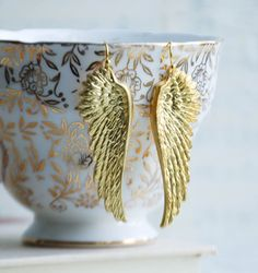 Angel wings and tea cups.  2 of my favorite things in one place. (Actually, I like tea more than tea cups.  English Breakfast.).