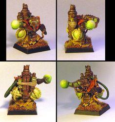 Wonderful Globadier conversion. Ork bike parts, Doomwheel crew head and arm, Stormvermin(?) body, wizard hand.