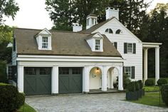 Wonderful garage - perfect way to make a three car look lovely! This garage would fit in well with our architecture. New England : Allan Greenberg