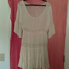 FREE PEOPLE..A BEAUTIFUL DRESS FOR SUMMER! And can go right into fall, add a jacket and some boots 2 OUTFITS FOR 2 SEASONS..A VERY PRETTY IVORY COLOR LACE ALL OVER IT ..SCOOP NECK LINE FLOWING SLEEVES..THIS DRESS IS SOO PRETTY..SIZE MEDIUM Free People Dresses Midi