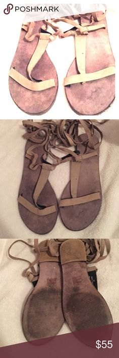 Free People gray Sandles Perfect for summer. Free People gray sandles that lace up around the calf. Wonderful condition only worn 3 times. Size 40 but fit like a 9 Free People Shoes