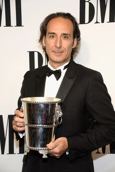 MAY 14, 2015 Honoree Alexandre Desplat poses with the BMI Icon Award during the 2015 BMI Film & Television Awards at the Beverly Wilshire Hotel on May 13, 2015 in Beverly Hills, California. (Photo by Frazer Harrison/Getty Images for BMI)