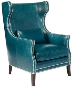 This substantial modified wing-back chair (in teal leather- silver nailhead trim) looks like it belongs in a library next to a crackling fireplace!   (turquoise, teal, aqua, decor)