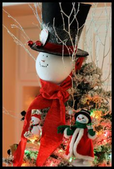 Snowman Tree Topper. I LOVE snowmen Christmas trees!!