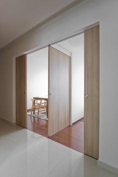 Wooden Elements Architects Home in Singapore: Natura Loft Apartment by AO Studios