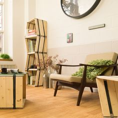 Moveo LXXX. Upcycled furniture by Reditum, locally manufactured in Cologne. 3 units at 40 H x 40 W x 35 D in cm. Materials: one-way pallets and metal, bicycle tubes.