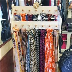 Here a Scarves Wood Peg Display in Pharmacy. A wooden rack creates a compact means of Merchandising in Drug-Store-cum-Gift-Shoppe Edgewood Pharmacy. Scarf Display, Scarf Knots, Wooden Rack, Painting Frames, Pharmacy, Scarves, Scarfs, Apothecary, Framed Art