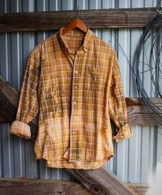 Distressed vintage flannel in orange from Mad Mary's Boutique
