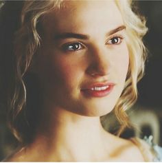 Lily James (as Cinderella). She's too cute to leave out