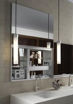Mirror that lifts up to disclose a hidden cabinet.  Robern Uplift Mirror