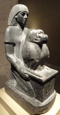 """Granodiorite statue of a man named Minemheb, accompanied by a baboon representing Thoth. Artist unknown; from the reign of the 18th Dynasty Pharaoh Amenhotep III """"the Magnificent"""" (ca. 1390-1350 BCE). Now in the Cleveland Museum of Art."""