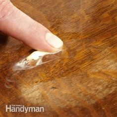 The oil from the petroleum jelly will often penetrate the finish and remove the ring or at least make it less visible.