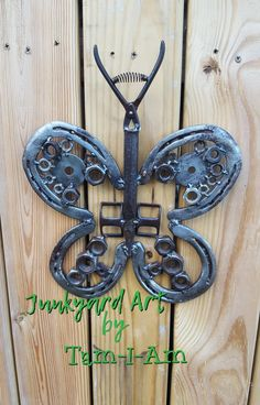 Junkyard Art by Tam-I-Am.  Scrap metal art. Repurposed horseshoes, nuts, washers, and a pair of wire cutters.