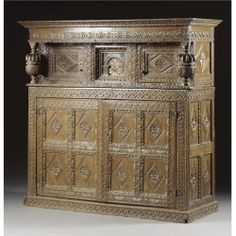 A PRESS CUPBOARD, CHARLES I, FIRST HALF 17TH CENTURY carved oak, restorations and some later carving