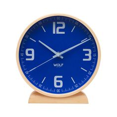 """Modern in design, the Claude 8"""" Round Mantel Clock is a handsomely designed clock for a bedroom or living room tabletop.  With its wooden frame, this clock is a natural take on contemporary style.  A b...  Find the Claude 8"""" Round Mantel Clock, as seen in the We're Obsessed with Nordic Design Collection at http://dotandbo.com/collections/were-obsessed-with-nordic-design?utm_source=pinterest&utm_medium=organic&db_sku=102313"""